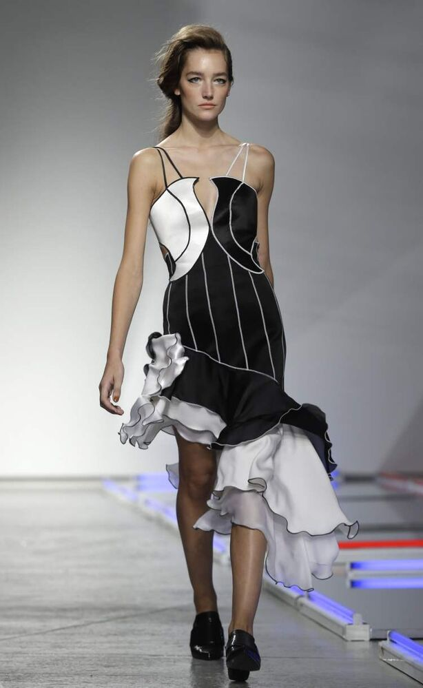 The Rodarte Spring 2014 collection is modelled during Fashion Week in New York, Tuesday, Sept. 10. (AP Photo / Seth Wenig)