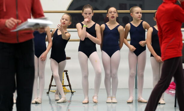 Young dancers wait for their cue in a rehearsal studio to begin another run through of RWB's Nutcracker.