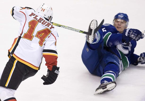 The Vancouver Canucks' Christian Ehrhoff (right) gets a taste of Fleury's grit during a game in 2009. (Jonathan Hayward / The Canadian Press files)</p>
