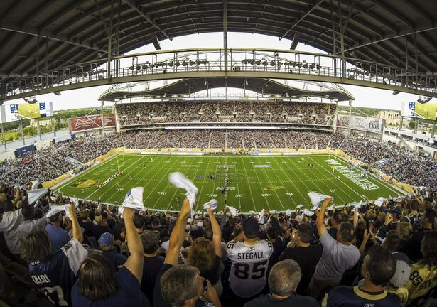 <p>The crowd at the inaugural regular season game at Investors Group Field in Winnipeg on June 27, 2013.</p>