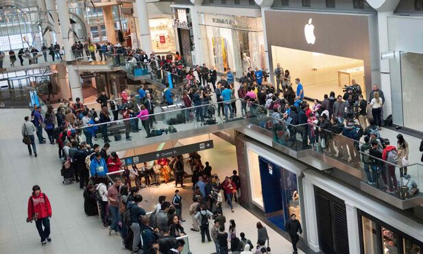 More than 1,000 people were in line to buy the iPhone 6 in Toronto on Friday. Globally, the firm sold has sold more than 10 million units of its latest model.