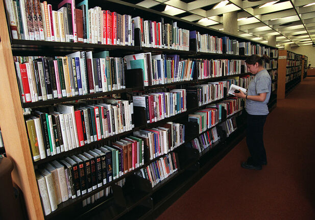 Winnipeg's Millennium Library, above, along with all other city libraries will remain closed while the city determines how to handle sites full of high-touch objects, including books.