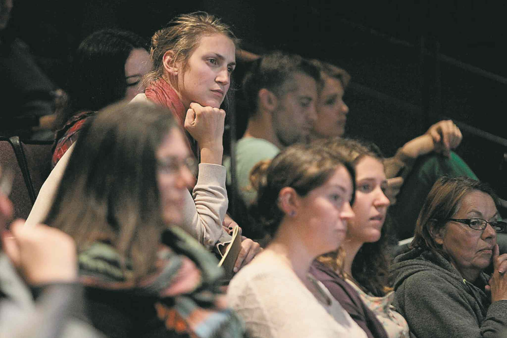 A spectator listens as mayoral candidates square off at the U of W Tuesday.