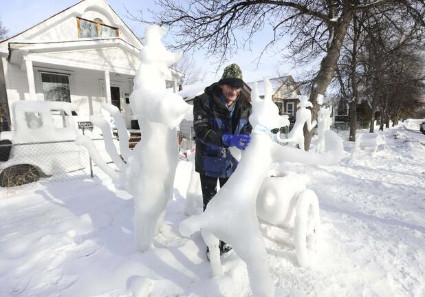 Leigh Keast fights off winter doldrums by creating ice sculptures in his front yard, which is currently home to an array of Looney Tunes characters.</p>