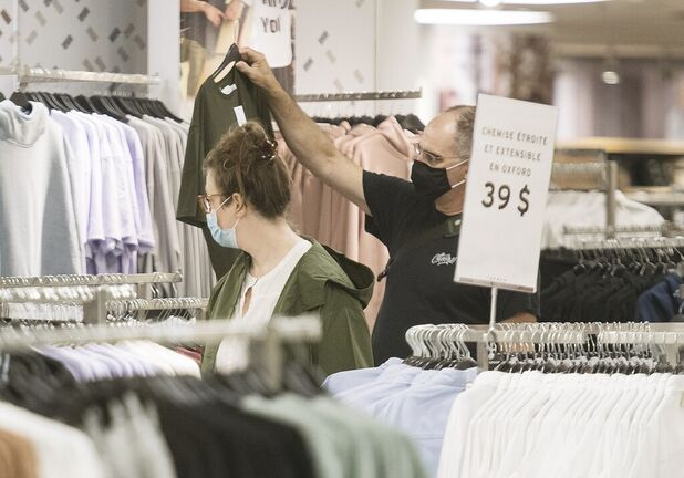 Wearing a mask in retail environments is starting to become the norm. (Graham Hughes / The Canadian Press files)