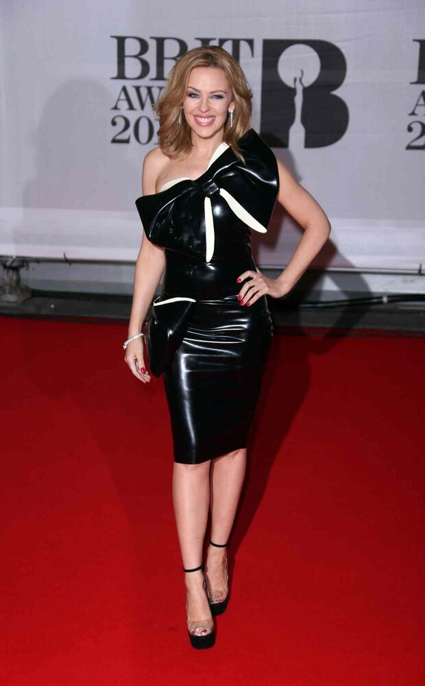 Australian singer Kylie Minogue arrives at the BRIT Awards 2014 at the O2 Arena in London.