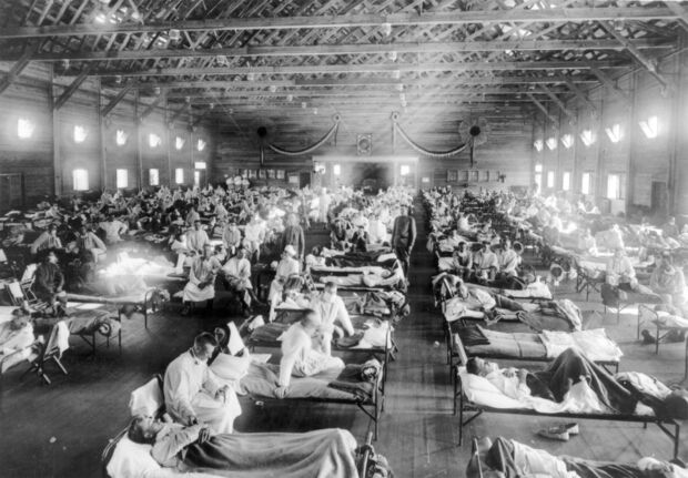 NATIONAL MUSEUM OF HEALTH AND MEDICINE / TNS FILES</p><p>Influenza epidemic patients lie on cots at the Emergency Hospital in Camp Funston, Kansas during the 1918 Spanish influenza outbreak. </p>