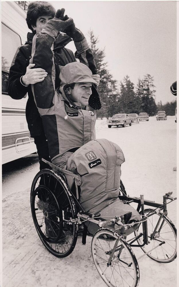 Rick Hansen does some stretching exercises before hitting the road after his mid-day break (about 2 hours long) on the Trans-Canada Highway about thirty miles (49 Kilometres) west of Falcon Lake, MB. Wayne Glowacki / Winnipeg Free Press Archives January 17, 1987