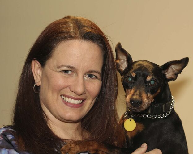 Veterinarian Dr. Sarah Silcox poses with her dog, Blackberry. (Supplied)</p>