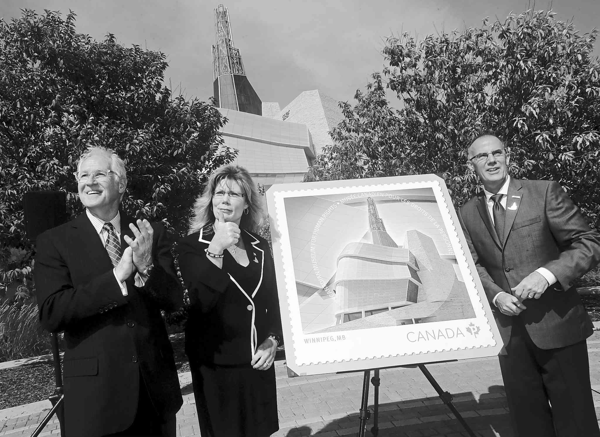 Stuart Murray (left) and MP Shelly Glover in August  unveiled a stamp commemorating the new rights museum, along with Canada Post official Bill Davidson.