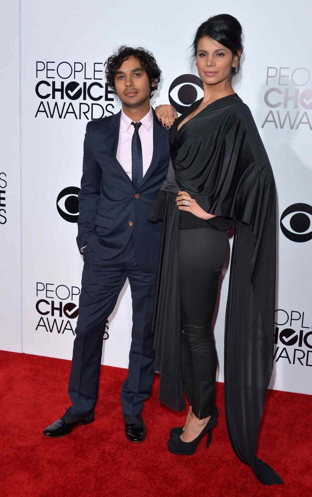 The Big Bang Theory's Kunal Nayyar, left, and Neha Kapur arrive at the 40th annual People's Choice Awards at Nokia Theatre L.A. Live on Wednesday. (John Shearer / Invision/The Associated Press)
