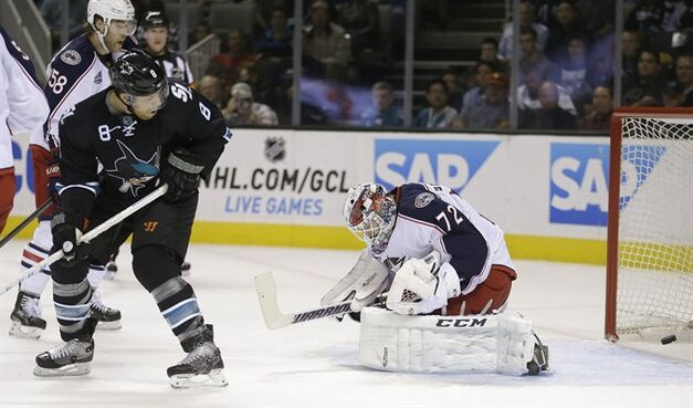 San Jose Sharks' Joe Pavelski, left, scores a goal past Columbus Blue Jackets goalie Sergei Bobrovsky (72) during the first period of an NHL hockey game Thursday, Oct. 23, 2014, in San Jose, Calif. (AP Photo/Ben Margot)