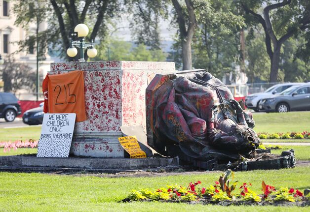 RUTH BONNEVILLE / WINNIPEG FREE PRESS  Local - Leg Statue down  Photo of the statue of Queen Victoria on the front lawn of the Manitoba Legislative Building lays on the ground after being  toppled off its base on Canada Day.     July 02, 2021