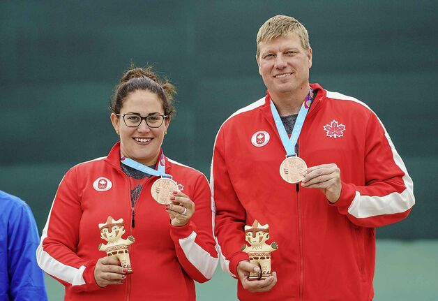 Amanda Chudoba and Curtis Wennberg win bronze in mixed team trap shooting at the Lima 2019 Pan American Games on July 31.