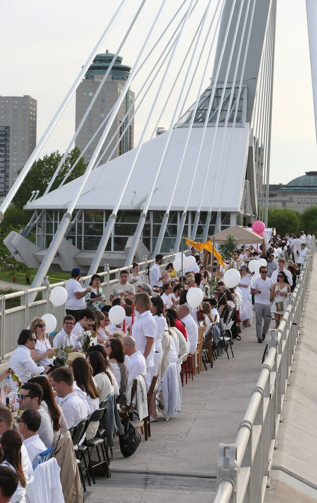 Diners enjoy themselves at the Table for 1200 event on the Esplanade Riel Bridge on a perfectly temperate Saturday evening.