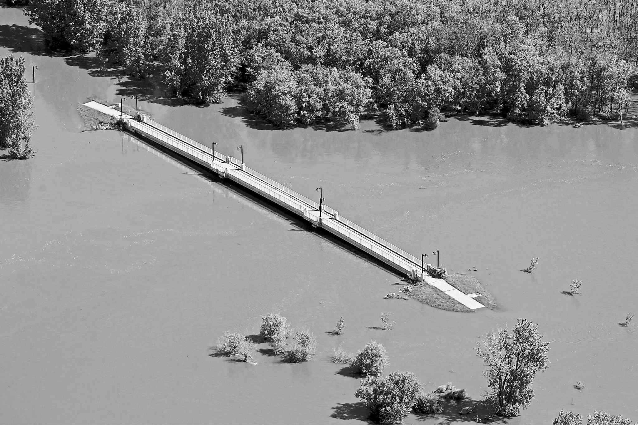 Assiniboine River flooding in Brandon this spring. Ongoing flooding in the region has changed the perception of cost and benefit.
