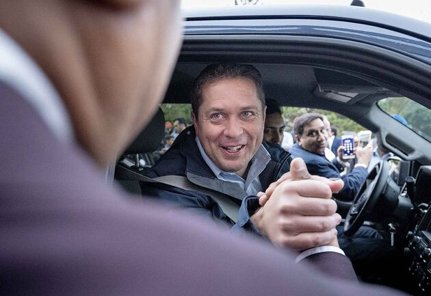 Conservative Leader Andrew Scheer shakes hands with a supporter while at a campaign stop in Brampton, Ont. on Friday.