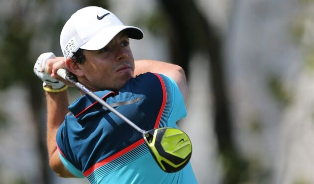 Rory McIlroy of Northern Ireland tees off on the 2nd hole during the final round of the Dubai Desert Classic golf tournament in United Arab Emirates, Sunday, Feb. 1, 2015. (AP Photo/Kamran Jebreili)