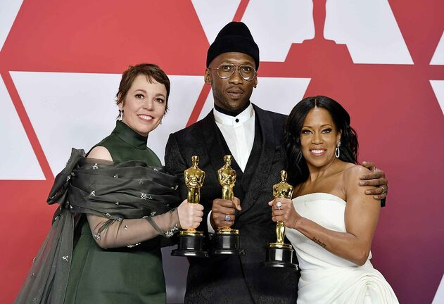 Olivia Colman poses with the award for best performance by an actress in a leading role for The Favourite, Mahershala Ali poses with the award for best performance by an actor in a supporting role for Green Book, and Regina King poses with the award for best performance by an actress in a supporting role for If Beale Street Could Talk at the Oscars on Sunday. (Jordan Strauss/Invision/AP)