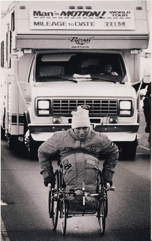 Rick Hansen faced Prairie winds again yesterday on Trans-Canada Highway as he took his Man in Motion tour out of Winnipeg, almost a week behind schedule. He has raised $300,000 during ten days in Manitoba. Dave Johnson / Winnipeg Free Press Archives January 29, 1987