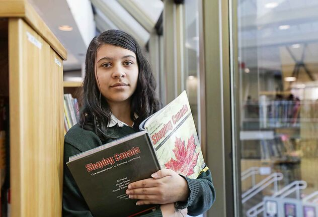 RUTH BONNEVILLE  /  WINNIPEG FREE PRESS     local - Balmoral Hall equity conference      EQUITY CONFERENCE – Balmoral Hall students host its third annual Equity Conference on Indigenous languages and art  Tuesday.     Photo of Balmoral Hall grade 10 student - Sarah Mathews with one of the text books on Indigenous studies her and her class are working on.     The conference was launched in order to comply with the TRC's calls to action around implementing age appropriate curriculum on residential schools, treaties and Indigenous peoples' histories.     See story by MAGGIE Macintosh   Feb 11th,, 2020