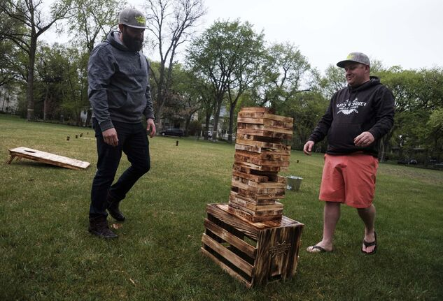 Daniel Crump / Winnipeg Free press</p><p>Ashley Nichol (left) and Steve Wesselingplay a game of wobbly wenga.</p>