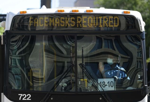Daniel Crump / Winnipeg Free Press. An unidentified man attempts to board a Winnipeg Transit bus without a mask. The City of Winnipeg now requires that masks be warn on city buses. August 29, 2020.</p>