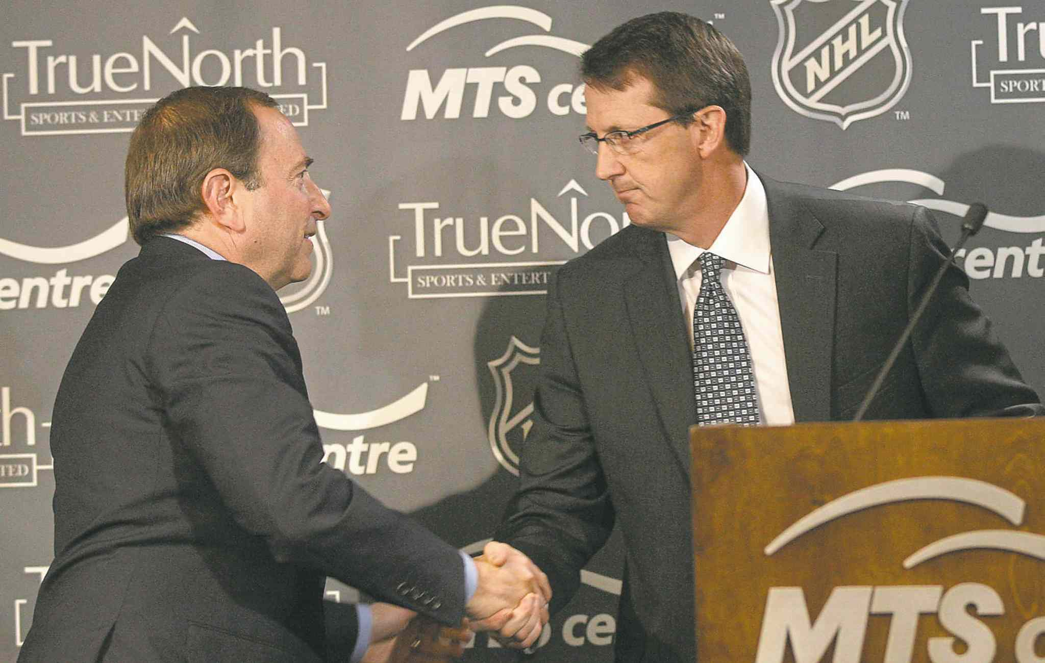 Mark Chipman (right) is congratulated by NHL commissioner Gary Bettman after the  May 2011 announcement the NHL was returning  to Winnipeg.