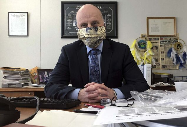 Editor Paul Samyn posted a picture of himself wearing a face mask made out of newspaper print fabric by Brenda Suderman.