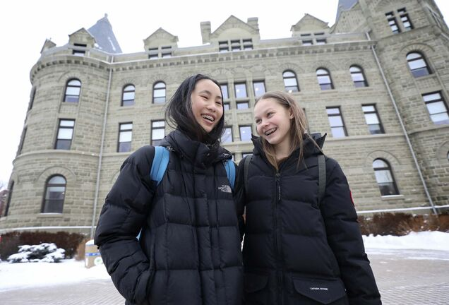 Elisa Woo, left, and Taisi Tollasepp at the University of Winnipeg Collegiate, where Grade 9 to 12 students complete the academic portion of their day.
