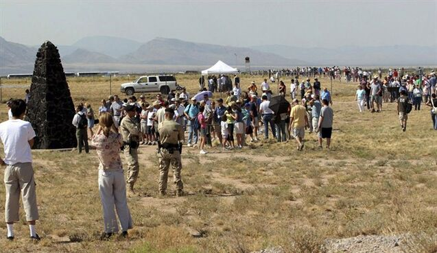 FILE - In this Saturday, July 16, 2005 file photo, a crowd of visitors gathers at the Trinity Site, where the first atomic bomb was tested 60 years ago, at White Sands Missile Range, N.M. Seven decades after an atomic bomb helped end World War II, families in New Mexico's Tularosa Basin want tourists to know nearby residents later suffered from health problems. Protesters are planning a demonstration Saturday, April 4, 2015, as the Trinity Test site opens to visitors. (AP Photo/Randy Siner, File)