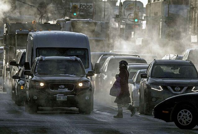 Wreathed in exhaust fog pedestrians and traffic at Portage and Maryland dealt with the -30C temperatures on the evening commute home.. See story. January 30, 2019