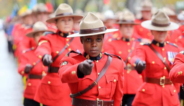 RCMP officers march down Broadway towards the Legislative Building, Sunday, Sept. 28, as part of the annual police memorial.