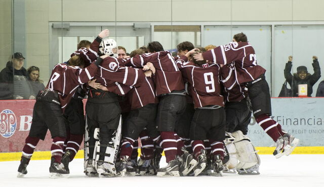 St. Paul's Crusaders celebrate their 7-2 victory over Vincent Massey Trojans in the Winnipeg High School Hockey League Championship game Wednesday at MTS Iceplex.