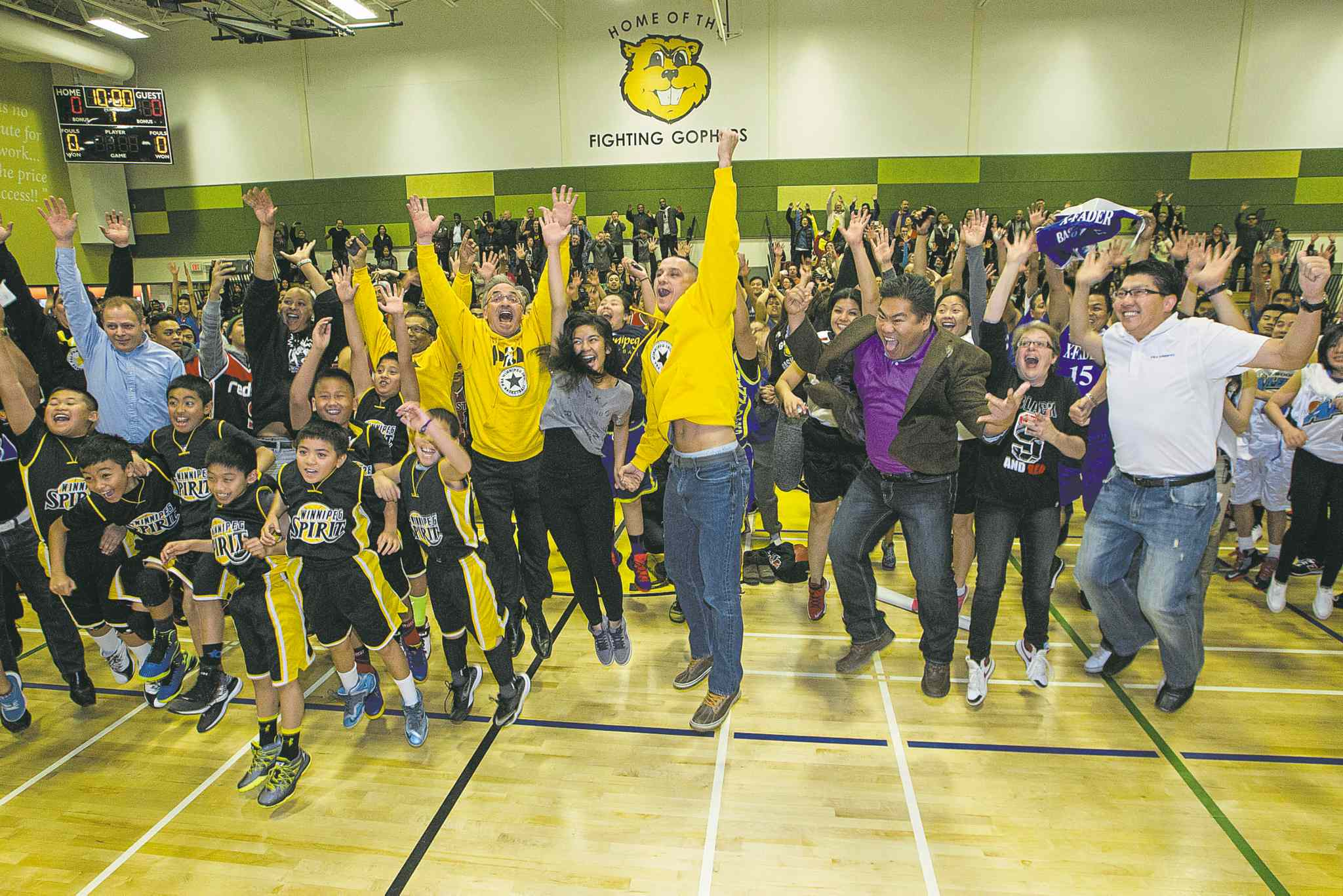 MIKE DEAL / WINNIPEG FREE PRESS�Winnipeg�s biggest jump shot� � led by Kevin Chief (centre), NDP cabinet minister and former University of Winnipeg basketball player.