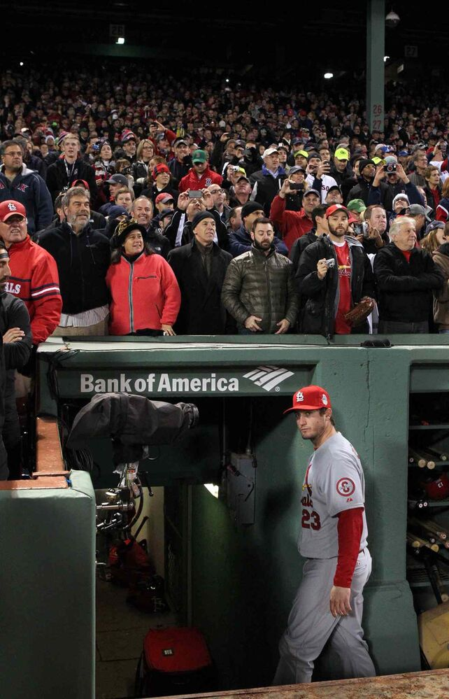 The St. Louis Cardinals' David Freese has one last look at the celebrating Boston Red Sox before leaving the dugout.