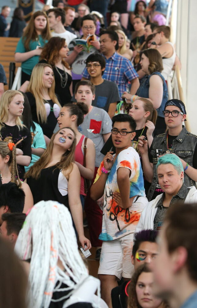 A colourful crowd of concert-goers wait for the doors to open at the MTS Centre for the Lady Gaga show.  (Jason Halstead / Winnipeg Free Press )