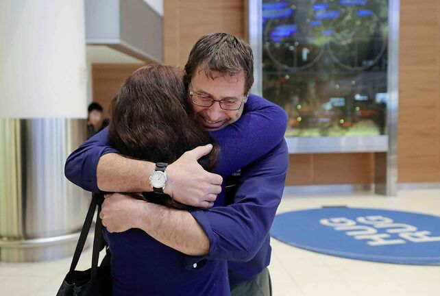 RUTH BONNEVILLE  /  WINNIPEG FREE PRESS    Andrew Prokopchuk is all smiles as he's greeted by his wife Patti.