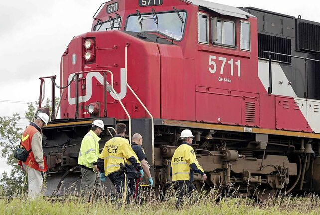 Police arrested three people attempting to sneak aboard a Toronto-bound CN freight train in the Transcona yards in Winnipeg.