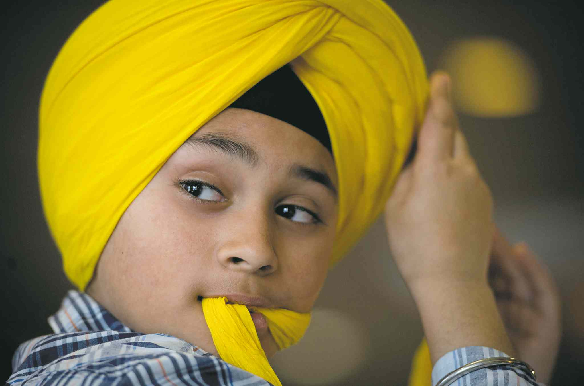 A competitor takes part in a turban tying competition in Surrey earlier this year. The city has a vibrant South Asian culture.