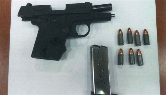 """In this photo released Wednesday, Jan. 28, 2015 by the The Transportation Security Administration, a hand gun, magazine and ammunition is shown in Atlanta. Former reality television star Benzino says he made an """"honest"""" mistake the day following his arrest at the Atlanta airport after a loaded handgun was found in his carry-on bag. Benzino, who real name is Raymond Scott, told The Associated Press on Wednesday that he forgot to remove his loaded gun. (AP Photo/TSA)"""