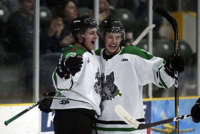 Joey Moffatt (left) celebrates with Caelan McPhee last season. The team's leading scorer was hoping to win the league championship in front of his friends and family. (Phil Hossack / Winnipeg Free Press files)