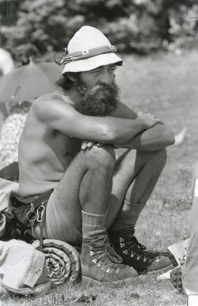 A festival goer sits on the Winnipeg Folk Festival grounds on July 14, 1980. (WINNIPEG FREE PRESS)