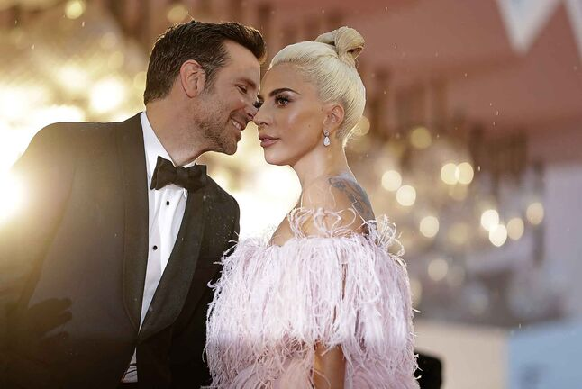 Lady Gaga (left) and Bradley Cooper pose for photographers upon arrival at the premiere of the film 'A Star Is Born' at the 75th edition of the Venice Film Festival in Venice, Italy, Friday, Aug. 31, 2018. (AP Photo/Kirsty Wigglesworth)