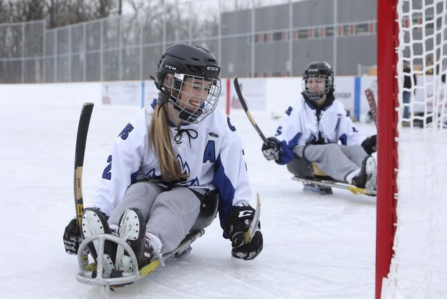 <p>Kassidy Paluck a member of the Coll&#232;ge Jeanne-Sauv&#233; hockey team plays sledge hockey with her teammates on the newly opened fully accessible Jumpstart outdoor rink at Dakota Community Centre Tuesday.</p>