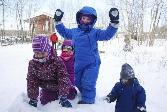 Bailey, 4, (from left) Tessa, 4, Josie, 4, and Neyla, 3, love playing in the snow during self-directed play outdoors Monday morning at the FortWhyte Alive Forest School. A pre-school alternative where kids ages 3 to 5 spend the whole session outdoors in the woods, even in this cold weather.