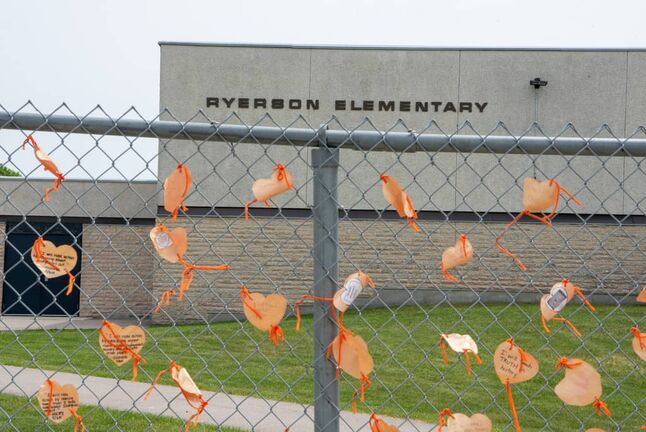 Orange hearts tied to the fence outside of  Ryerson School in Winnipeg. The elementary school is named after Egerton Ryerson, who is considered a chief architect of Canada's residential school system.