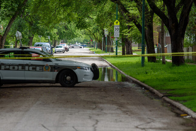 JESSE BOILY  / WINNIPEG FREE PRESS  Police look into a possible homicide at Salter and Flora on Wednesday. A resident nearby said that this was the fourth homicide on this block in four years. Wednesday, July 1, 2020.  Reporter: