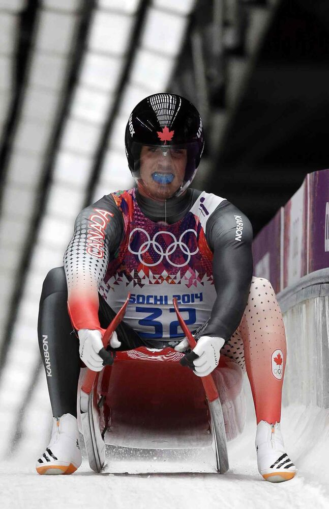John Fennell of Canada brakes in the finish area uring the men's singles luge final at the 2014 Winter Olympics. (Michael Sohn / The Associated Press)