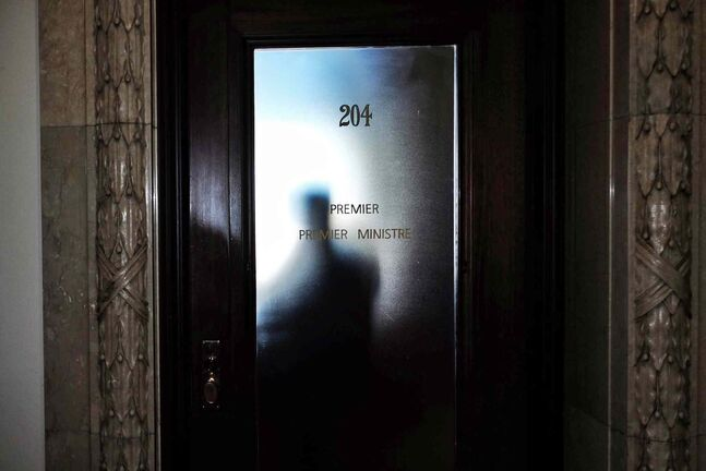 Who will be the next premier of Manitoba? A shadow is cast on the door of the premier's office in the Manitoba Legislative Building. (Mike Deal / Winnipeg Free Press files)